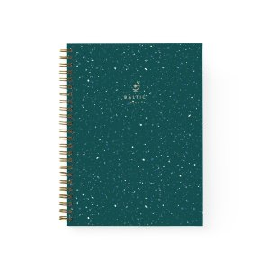 An emerald green, terrazzo printed notebook featuring a gold spiral binding