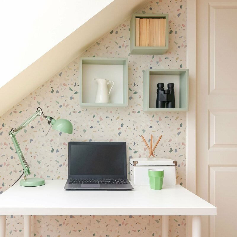terrazzo wallpaper acts as accent wall in home office