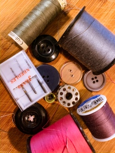 spools of thread and buttons sewing mending