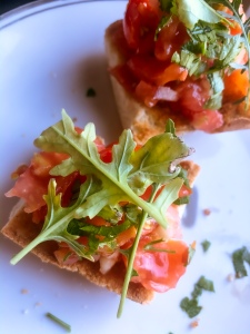tomatoes arugula on bread for a delicious vegetarian snack